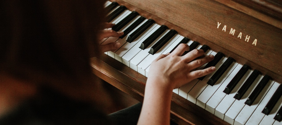 Woman learns how to play piano